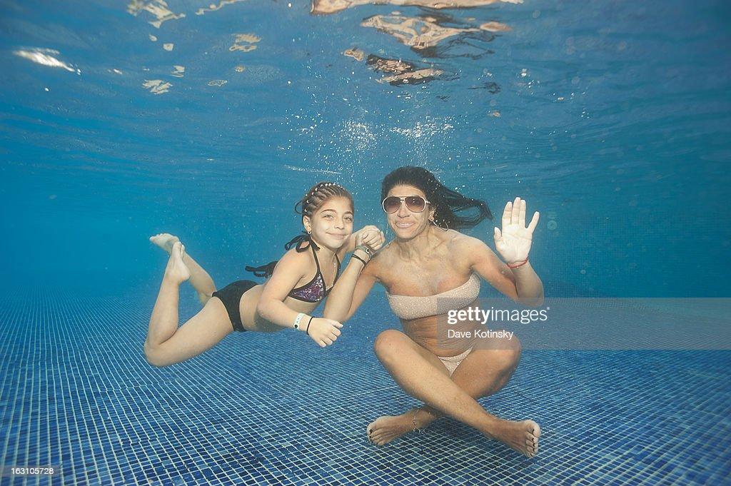 Teresa Giudice takes daughter Milania Giudice for a swim at Majestic Resort on March 4, 2013 in Punta Cana, Dominican Republic.
