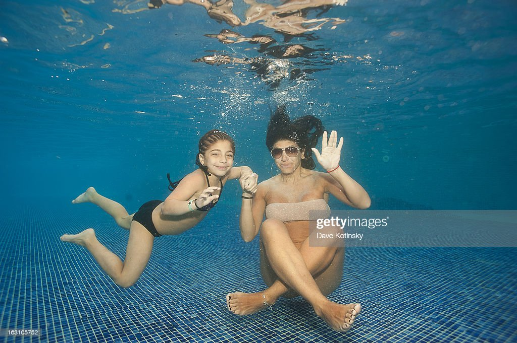 Teresa Giudice takes daughter Milania Giudice for a swim at Majestic Resort on March 4, 2013 in Punta Cana, Dominican Republic.