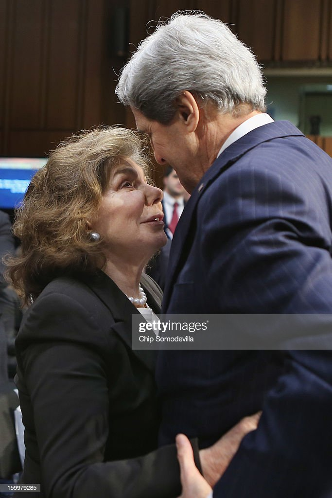 Teresa Heinz Kerry (L) congratulates her husband Sen. John Kerry (D-MA) after his confirmation hearing before the Senate Foreign Relations Committee to become the next Secretary of State in the Hart Senate Office Building on Capitol Hill January 24, 2013 in Washington, DC. Nominated by President Barack Obama to succeed Hillary Clinton as Secretary of State, Kerry has served on this committee for 28 years and has been chairman for four of those years.