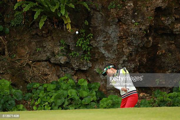 Teresa Lu of Taiwan chips onto the 14th green during the Daikin Orchid Ladies Golf Tournament at the Ryukyu Golf Club on March 6 2016 in Nanjo Japan
