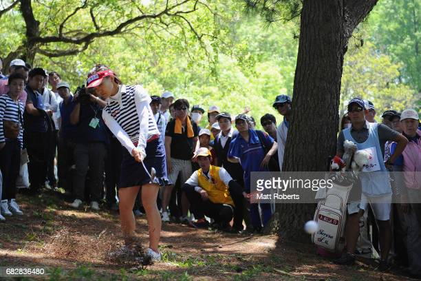 Teresa Lu of Taiwan hits from the trees on the 14th hole during the final round of the HokennoMadoguchi Ladies at the Fukuoka Country Club Wajiro...