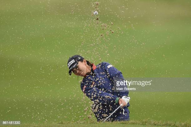 Teresa Lu of Taiwan hits out of the 15th green bunker during the final round of the Fujitsu Ladies 2017 at the Tokyu Seven Hundred Club on October 15...