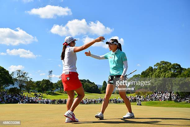 Teresa Lu of Taiwan hugs BoMee Lee of South Korea after winning putt on the 18th green during the final round of the 48th LPGA Championship Konica...