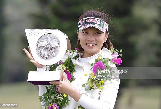 Teresa Lu of Taiwan lifts the winner's trophy during a ceremony following the Daikin Orchid Ladies Golf Tournament at the Ryukyu Golf Club on March 8...