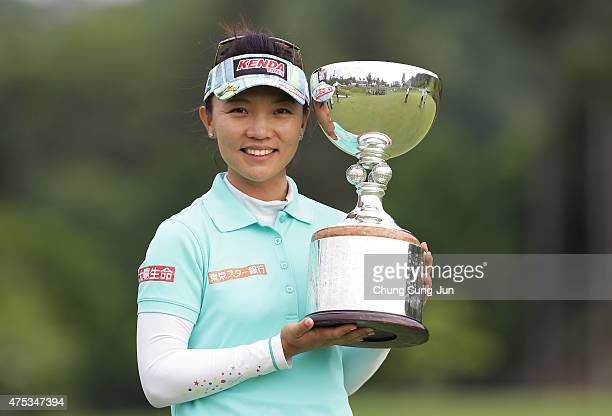Teresa Lu of Taiwan lifts the winner's trophy during a ceremony following the Resorttrust Ladies at the Maple Point Golf Club on May 31 2015 in...