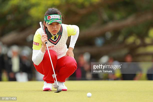 Teresa Lu of Taiwan lines up her putt on the 17th green during the final round of the Daikin Orchid Ladies Golf Tournament at the Ryukyu Golf Club on...