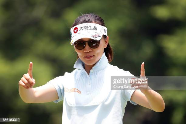 Teresa Lu of Taiwan reacts after a putt on the 9th green during the final round of the Chukyo Television Bridgestone Ladies Open at the Chukyo Golf...