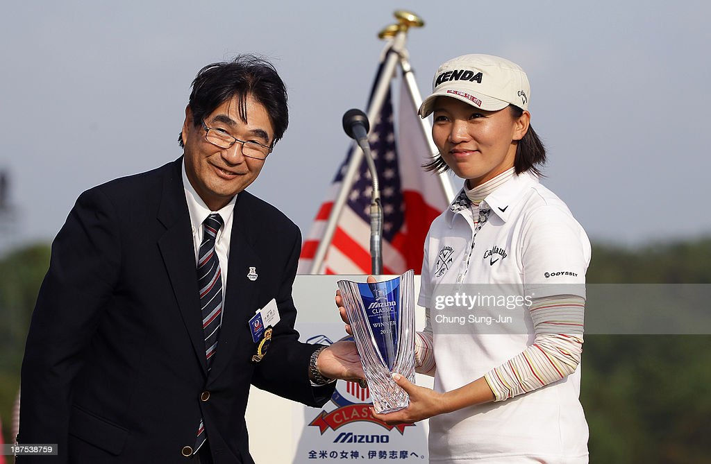 Teresa Lu of Taiwan receives the tournament trophy after the final round of the Mizuno Classic at Kintetsu Kashikojima Country Club on November 10, 2013 in Shima, Japan.