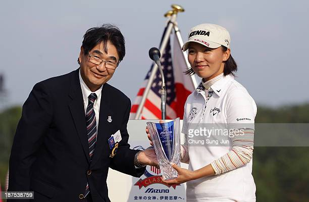 Teresa Lu of Taiwan receives the tournament trophy after the final round of the Mizuno Classic at Kintetsu Kashikojima Country Club on November 10...