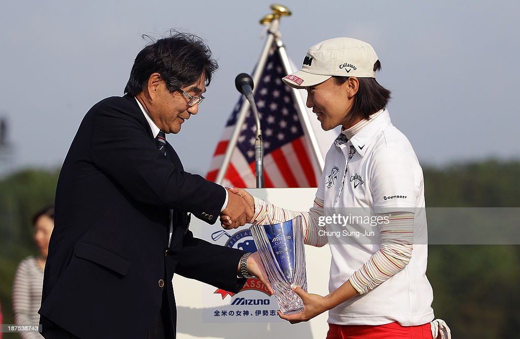 Teresa Lu of Taiwan receives the tournament trophy during the final round of the Mizuno Classic at Kintetsu Kashikojima Country Club on November 10, 2013 in Shima, Japan.