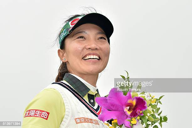 Teresa Lu of Taiwan smiles after winning the Daikin Orchid Ladies Golf Tournament at the Ryukyu Golf Club on March 6 2016 in Nanjo Japan