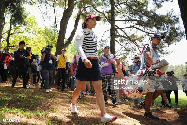 Teresa Lu of Taiwan walks to the fairway after her shot from the trees on the 14th hole during the final round of the HokennoMadoguchi Ladies at the...