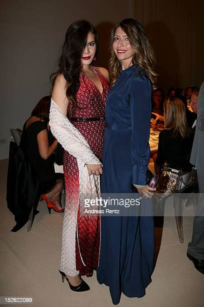 Teresa Missoni and Valentina Micchetti attend the amfAR Milano 2012 Cocktail reception during Milan Fashion Week at La Permanente on September 22...