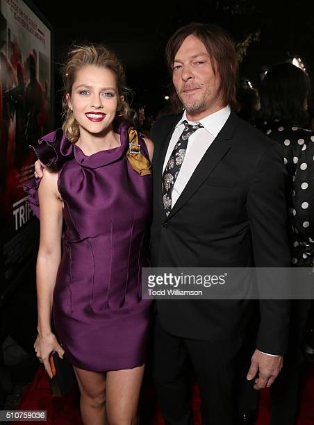 Teresa Palmer and Norman Reedus attend the premiere Of Open Road's 'Triple 9' at Regal Cinemas LA Live on February 16 2016 in Los Angeles California