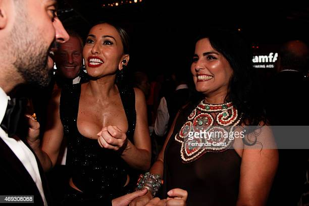 Tereza Collor and Sabrina Sato attend the 5th Annual amfAR Inspiration Gala at the home of Dinho Diniz on April 10 2015 in Sao Paulo Brazil