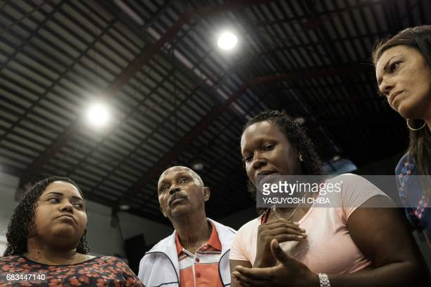 Tereza de Cassia Rosa Genoveva whose brother Cosme was taken by the police and found shot dead in May attends a press conference held by the Center...