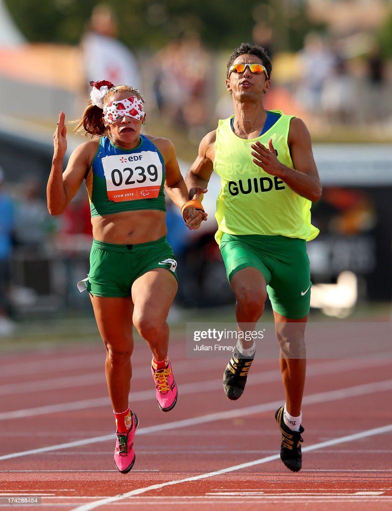 Terezinha Guilhermina and guide, Guilherme Santana of Brazil in action on their way to winning the Women's 100m T11 final during day four of the IPC Athletics World Championships on July 23, 2013 in Lyon, France.