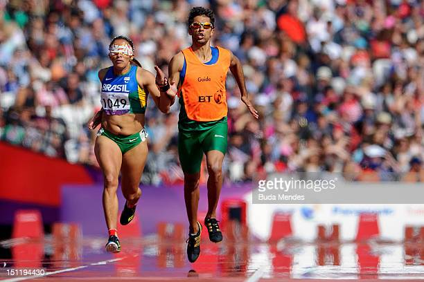 Terezinha Guilhermina of Brazil and her guide Guilherme Soares de Santana compete in the Women's 400m T12 on day 5 of the London 2012 Paralympic...