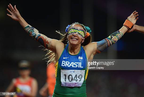 Terezinha Guilhermina of Brazil celebrates as she wins gold with guide Guilherme Soares de Santana in the Women's 100m T11 Final on day 7 of the...