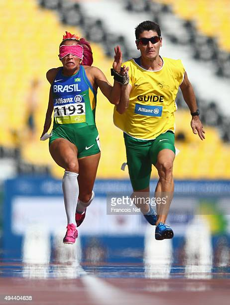 Terezinha Guilhermina of Brazil competes in the women's 100m T11 heats during the Morning Session on Day Six of the IPC Athletics World Championships...