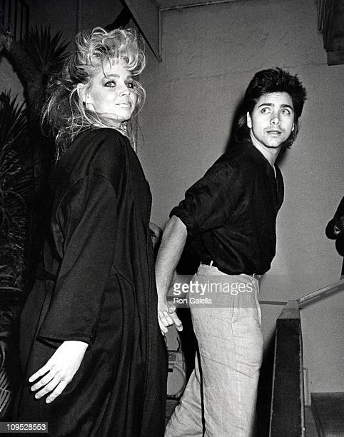 Teri Copley and John Stamos during Party For Hall Oates December 17 1984 at Spago's Restaurant in Hollywood California United States