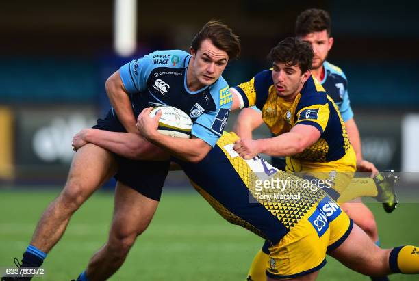 Teri Gee of Cardiff Blues is tackled by Jack Singleton and Sam Lewis of Worcester Warriors during the AngloWelsh Cup match between Cardiff Blues and...