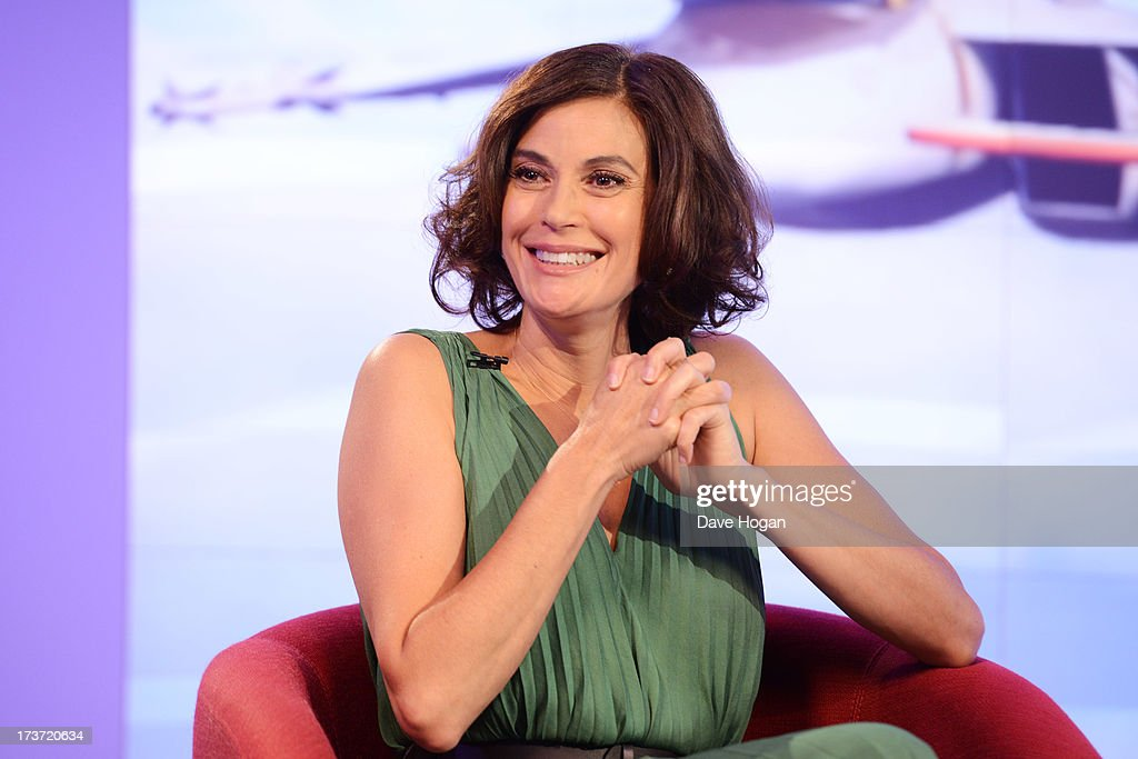 <a gi-track='captionPersonalityLinkClicked' href=/galleries/search?phrase=Teri+Hatcher&family=editorial&specificpeople=202145 ng-click='$event.stopPropagation()'>Teri Hatcher</a> takes part in a webchat to promote her new film 'Planes' on July 17, 2013 in London, England.