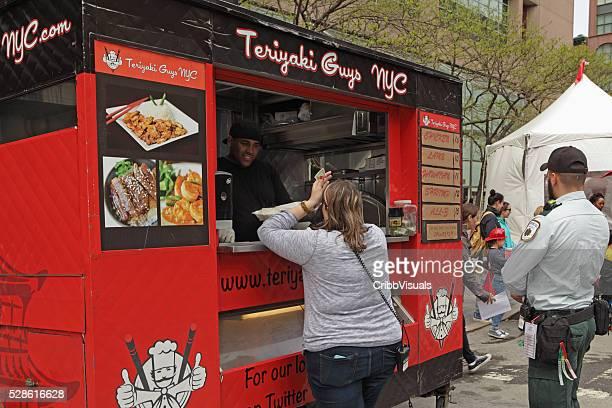 Teriyaki Guys NYC mobile food vendor serves a customer