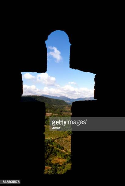 Termes The Corbieres Massif viewed through a cruciform window along the ramparts of the castle