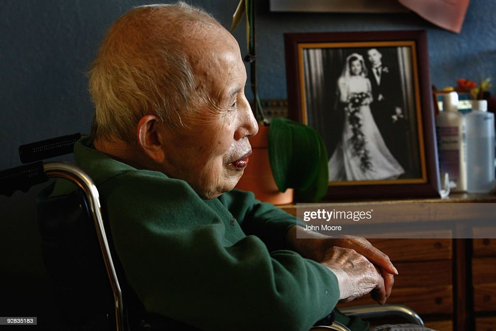 Terminally ill hospice resident Chiu Ning Yuan, 89, sits near a wedding photo from his youth in his room at the Hospice of Saint John on November 5, 2009 in Lakewood, Colorado. The non-profit hospice accepts patients regardless of their ability to pay, although most are covered by Medicare or Medicaid. End of life care has become a contentious issue in the current national debate on health care reform.