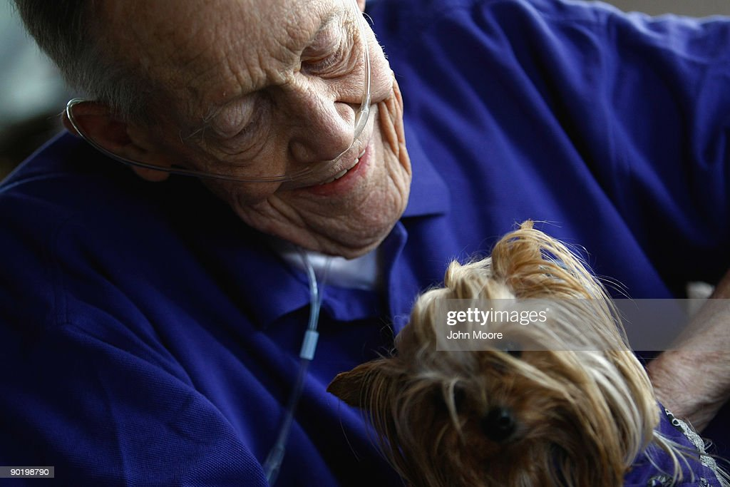 Terminally ill patient Bud Anderson holds therapy dog, yorkie Sally Sue, during a home hospice visit to his house on August 31, 2009 in Lakewood, Colorado. The non-profit Hospice of Saint John, which serves on average 200 people at a time, most of them home care patients, is the second oldest hospice in the United States. The hospice accepts patients regardless of their ability to pay, although most are covered by Medicare or Medicaid. The goal of the center is to maintain quality of life, manage pain, and offer spiritual guidance for residents in the last stage of their lives. End of life care has become a contentious issue in the current national debate on health care reform.