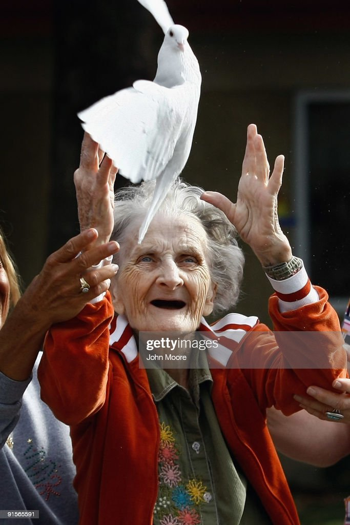 Terminally ill patient Jackie Beattie, 83, releases a dove on October 7, 2009 while at the Hospice of Saint John in Lakewood, Colorado. The dove releases are part of an animal therapy program designed to increase happiness, decrease loneliness and calm terminally ill patients during the last stage of life. The non-profit hospice, which serves on average 200 people at a time, is the second oldest hospice in the United States. The hospice accepts patients regardless of their ability to pay, although most are covered by Medicare or Medicaid. End of life care has become a contentious issue in the current national debate on health care reform.