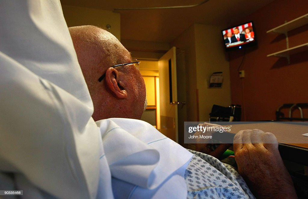 Terminally ill with brain cancer Mac McConlogue watches as President Barack Obama addresses a joint session of Congress on health care reform on...