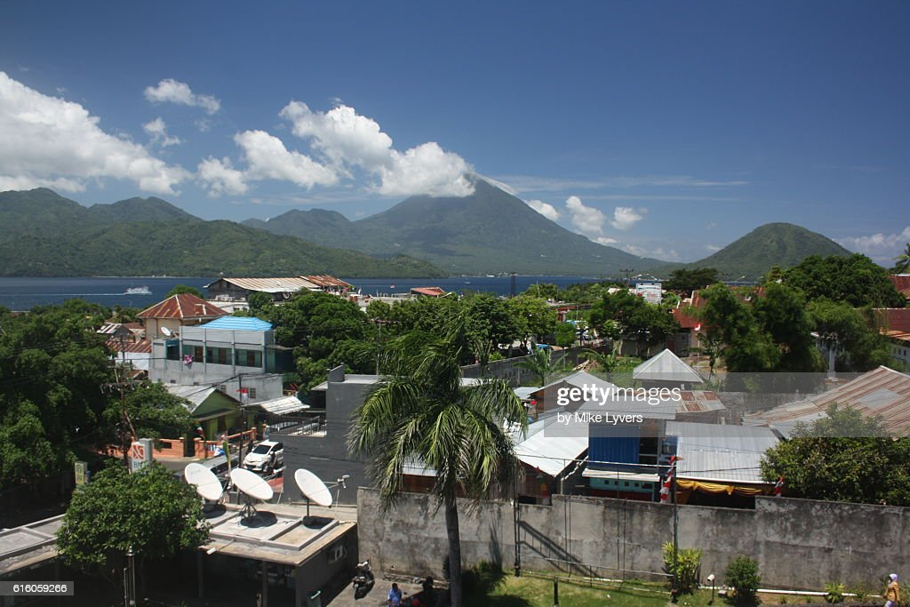 Ternate city with volcanic Tidore Island beyond : Stock Photo