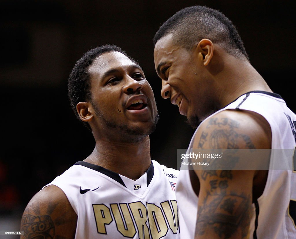 Terone Johnson #0 and Jacob Lawson #34 of the Purdue Boilermakers share a laugh in the closing minutes against the Illinois Fighting Illini at Mackey Arena on January 2, 2013 in West Lafayette, Indiana. Purdue defeated Illinois 68-61.