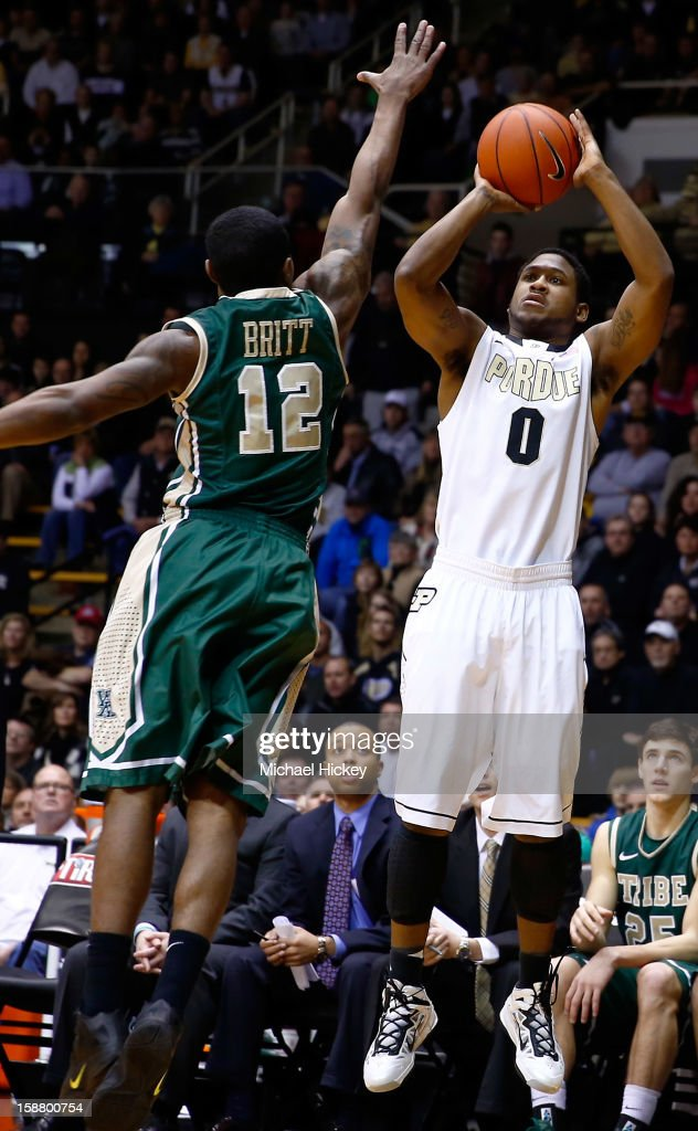 Terone Johnson #0 of the Purdue Boilermakers shoots against Brandon Britt #12 of the William & Mary Tribe at Mackey Arena on December 29, 2012 in West Lafayette, Indiana. Purdue defeated William & Mary 73-66.
