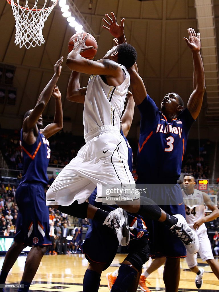 Terone Johnson #0 of the Purdue Boilermakers shoots the ball against Brandon Paul #3 of the Illinois Fighting Illini at Mackey Arena on January 2, 2013 in West Lafayette, Indiana.