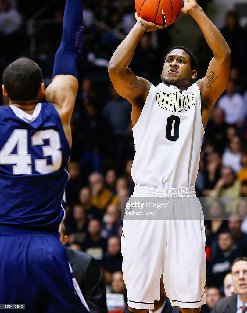 Terone Johnson #0 of the Purdue Boilermakers shoots the ball against Ross Travis #43 of the Penn State Nittany Lions at Mackey Arena on January 13, 2013 in West Lafayette, Indiana. Purdue defeated Penn State 60-42.