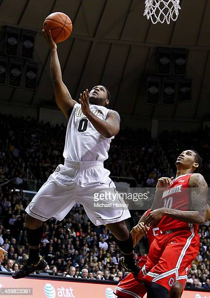 Terone Johnson of the Purdue Boilermakers shoots the ball as LaQuinton Ross of the Ohio State Buckeyes watches from behind at Mackey Arena on...