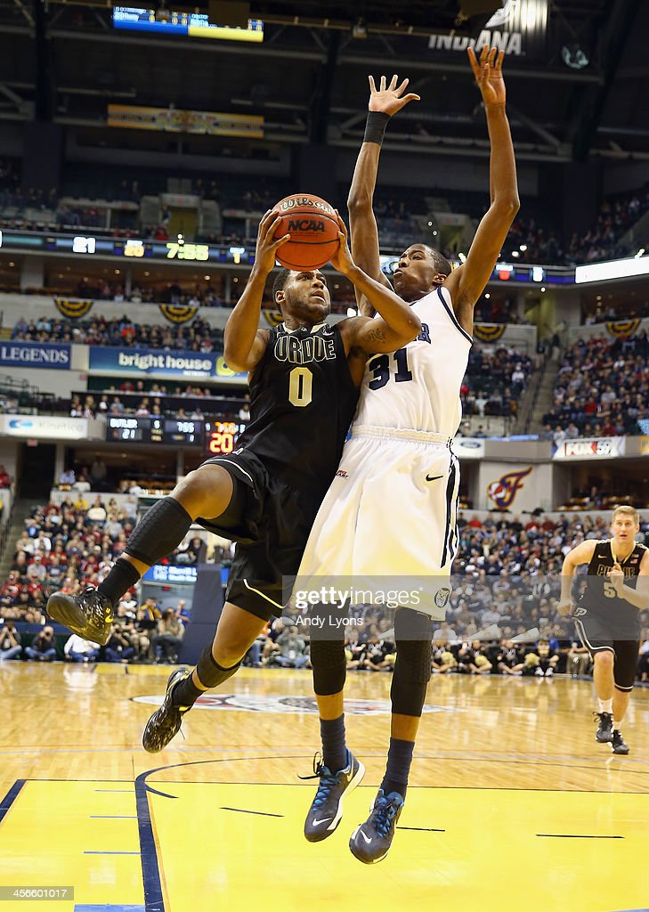 Terone Johnson #0 of the Purdue Boilermakers shoots the ball in the game against the Butler Bulldogs during the 2013 Crossroads Classic at Bankers Life Fieldhouse on December 14, 2013 in Indianapolis, Indiana.