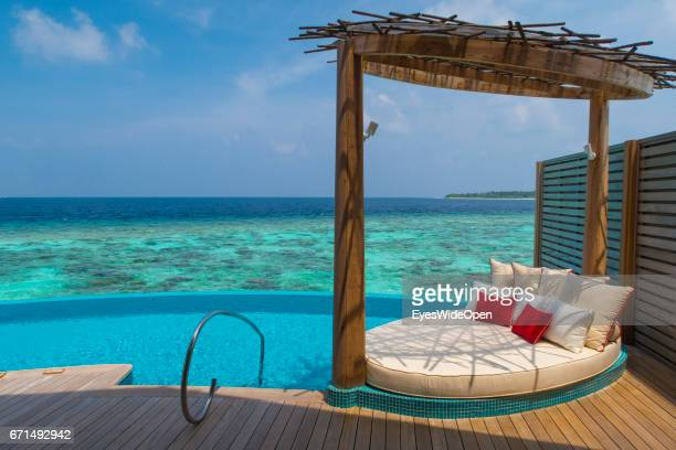 Terrace Deck with Infinity Pool and Sunbed of a Water Villa of the Lifestyle Resort Milaidhoo Island BaaAtoll on February 21 2017 in Male Maldives