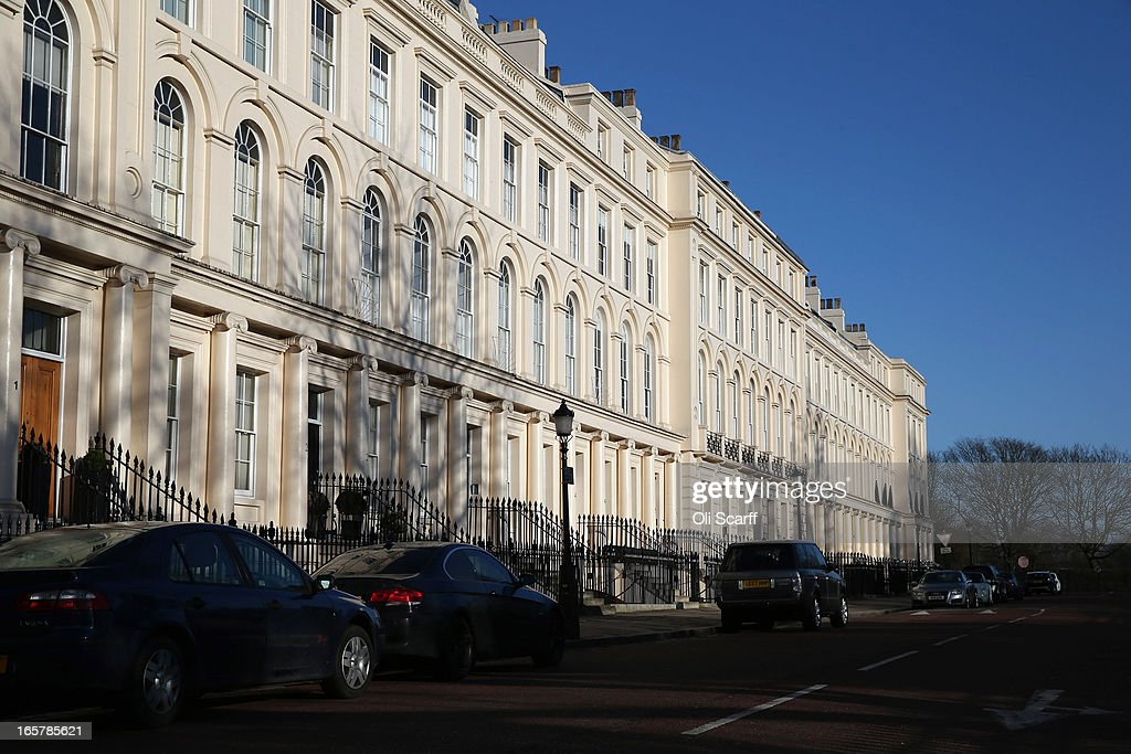 A terrace of residential properties in an affluent area of London adjacent to Regents Park on April 6, 2013 in London, England. Recent research has indicated that average monthly rents in central London have exceeded 5,000 GBP.