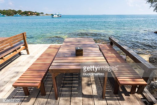 Terrace sea view with outdoor wood chairs and table : Stock Photo