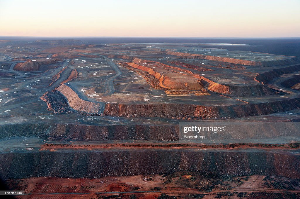 Terraced earth stands near the Fimiston Open Pit, known as the Super Pit, in Kalgoorlie, Australia, on Sunday, Aug. 4, 2013. The Super Pit is managed by Kalgoorlie Consolidated Gold Mines Ltd., jointly owned by Barrick Gold Corp., the world's largest producer of the metal, and Newmont Mining Corp., the second-largest gold producer. Photographer: Carla Gottgens/Bloomberg via Getty Images