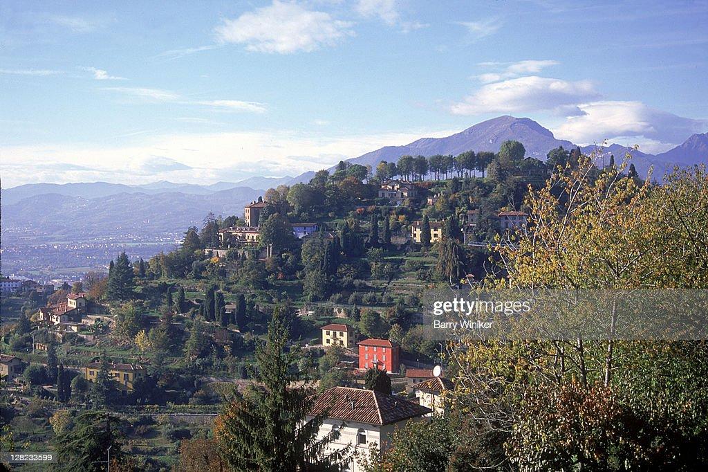 Terraced green land, villas, trees and mountains, Bergamo, Italy : Stock Photo