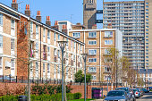 Terraced houses in contrast to council housing blocks, Balfron Tower, in the background