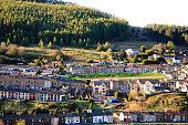 Terraced homes near Treorchy, Rhondda valley, Wales in the evening sun