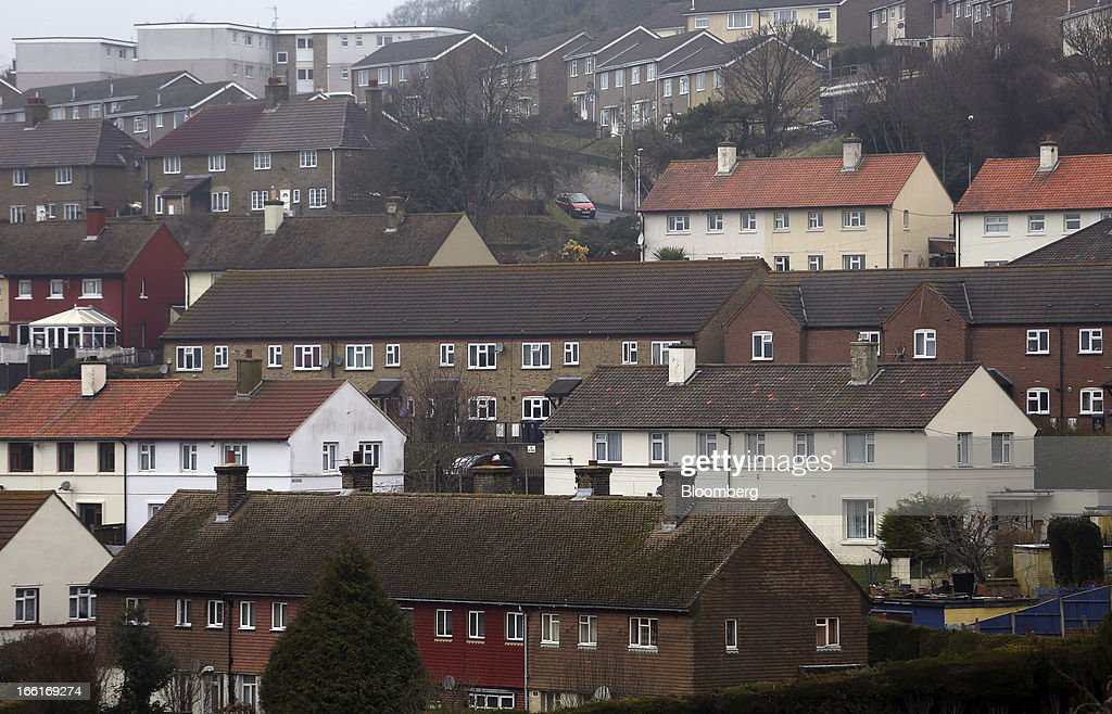 Terraced residential properties stand above the town of Dover UK on Tuesday April 9 2013 An index of UK house prices rose in March as transactions...