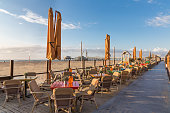 Terraces along the Dutch beach with a view at the famous Pier of Scheveningen