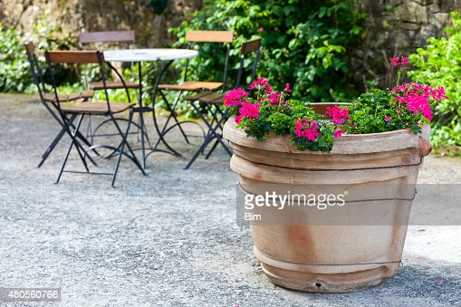 Terracota Vase With Flowers, Chairs and Table Outdoors, Tuscany, Italy : Stock Photo